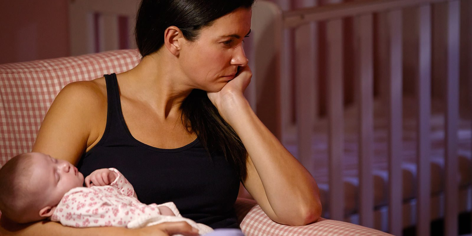 Woman Holding Child With Postpartum Depression